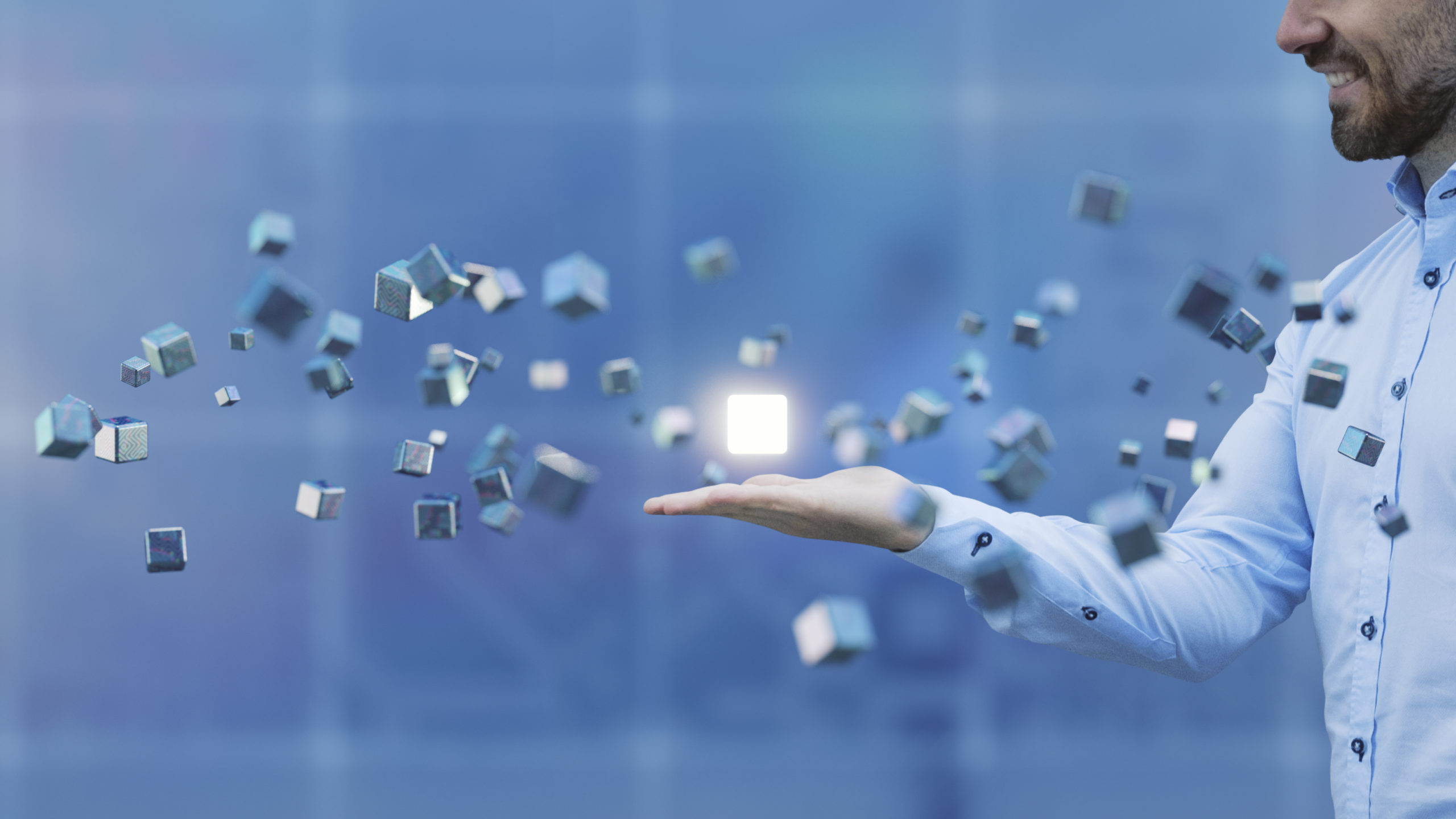 Businessman with flying cubes
